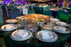 In lieu of the event's usual foliage-heavy centerpieces, printed photographs were scattered atop raised Lucite platforms, which were eventually also used to hold the night's family-style dinner platters (BizBash, Friends of the High Line)