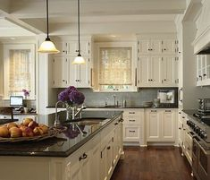 Kitchen with cream cabinets, grey counters & grey subway tile backsplash by LizaVorster