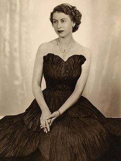 GLAMOUR QUEEN    Elizabeth poses in a glamorous evening gown and diamonds in the year she became monarch in a portrait by Dorothy Wilding, who had photographed the royal family since the late 1920s.