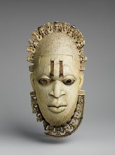 """Queen Mother Pendant Mask: Iyoba Benin Empire, 16th century The Metropolitan Museum of Art """"This ivory pendant mask is one of a pair of nearly identical works; its counterpart is in the British Museum in London. Although images of women are rare in..."""