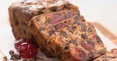 Dense, moist fruitcake packed with cherries, nuts, and dark chocolate.