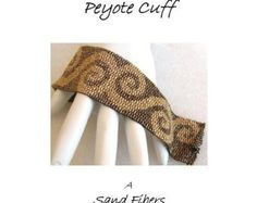 Intertwined is eligible for Sand Fibers 3-for- 2 Pattern Program.    Purchase any two Sand Fibers patterns and receive a third, of equal or lesser value, for free. Just specify your free pattern in the Notes to Seller during checkout. _____________________    The pattern in this listing is for my Intertwined cuff, which is created in odd count peyote. The pdf file includes    1. a large numbered graph of the pattern that can be used to create up to an 8.75 long beaded band,    2. tips on how…