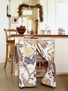 For extra storage in your kitchen, transform a standard utility cart, sold at most home centers, by giving it a skirt made out of your favorite fabric.  From Cottage Living.