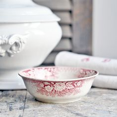 An antique French ironstone bowl with a red floral transferware pattern by Digoin & Sarreguemines
