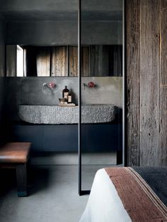 Bathroom | Raw rustic materials | Black cabinet | Old brushed wooden wall covering