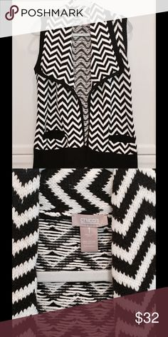 Chicos Chevron Open Sweater Vest Black White 1 M This is a great vest! Wide collar, open front, really soft. Chicos size 1, which is equal to a medium. It is quite roomy though and would likely fit a large. Excellent condition. Offers are always welcome and thanks for looking ❤ Chico's Sweaters
