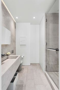 In the guest bathroom of this modern New York City apartment, the artwork is by Alexis Dahan, and the sink was designed by designed Jeffrey Dodd.