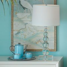 I think the lamp is clear and is picking up the aqua color from the decor.