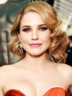 """And the Award for Best Beauty Goes To...   FIERCEST FAUX BOB: SOPHIA BUSH   Stylist Creighton Bowman says she was inspired by """"rock 'n' roll punk"""" to create Sophia's messy pinned-under do, but with her orange gown and smoky eye, all we see is a Hollywood goddess. T3 styling tools and multiple hairpins were responsible for the finished effect."""