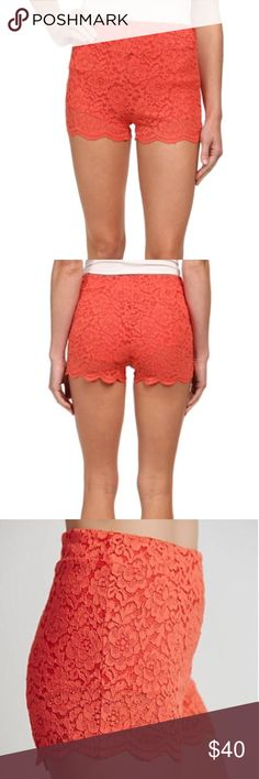 NWT Free People Dragonfruit Lace Shorts Size 2 NWT Free People lace shorts size 2.  Color is called dragon fruit   IMO they are a brighter orange/tangerine/coral-orange type colour. Exact color hard to describe, but appears closest to the close up pic with the zipper. Have side zipper. IMO are more of a higher rise/higher waist style! Free People Shorts