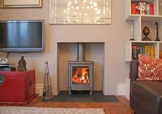 Rendered chamber with natural slate tiled hearth and a Contura wood stove fitted in Leigh on sea Essex 2012 Wood Burner Fireplace, Home Fireplace, Fireplace Surrounds, Fireplace Design, Fireplace Ideas, Wood Mantle, Exposed Brick Fireplaces, Log Burner Living Room, Slate Hearth