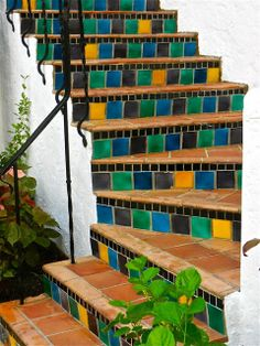 Wonderful colors in these tiled stairs - Thrifty Nifty Things