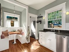 Built in kitchen bench, white and gray kitchen.  wooden floors