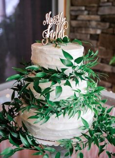 Ethereal wedding cake idea - three-tier, buttercream-frosted cake with greenery and calligraphy cake topper {Kelli Carrico Photography}