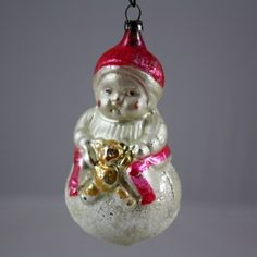Antique Mouth-Blown German Christmas Ornament - Girl Holding A Teddy Bear. Find today's version from Inge-Glas at www.mygrowingtraditions.com
