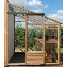 greenhouse lean to wood and glass - great idea for adding a chicken coop to the side of a shed, too