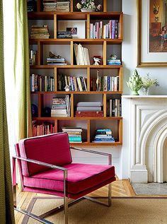A mid-century arm chair gets a modern update when upholstered in a gorgeous hot pink velvet.