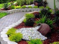 """What an interesting piece and a great, unique way to use some #bulkstone [ """"Pretty low-maintenance landscaping idea."""", """"Incorporate Landscape Walls, Interlocking Pavers and Natural Stone into your own Hardscape project. Come to any of RCPs 6 Store locations to view the wide variety of products we offer to create your own Dream Hardscape Oasis."""", """"Great contrasts of form, color, and texture. Love the \""""spilled water\"""" effect of the rocks and toppled clay urn."""", """"Mix glass beads & maybe..."""