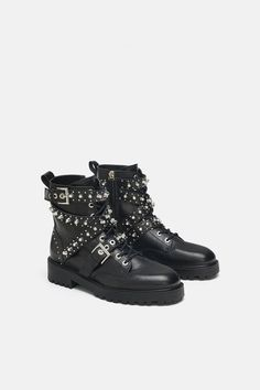 e06a5cb350f2 Flat black leather ankle boots. Embellished details. Embellished jewel  details on the front laces
