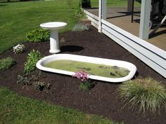 Instead of burying a plastic tub in your yard for your ducks to swim in, consider a used porcelain bath tub.  You could run the drain underground to a lower part of your garden for emptying/water plants.  A clawfoot tub above ground could also work...