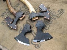 Axes by Nic Westermann. Not only is he a talented blacksmith but he's a nice guy too. Don't you just hate people like that?