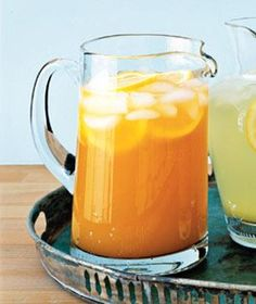 Tropical Lemonade:  1 1/2 cups freshly squeezed lemon juice, 1/2 cup sugar, 6 cups water, 2 6-ounce cans pineapple juice, 1 12-ounce can apricot nectar, 2 12-ounce cans ginger ale, lemon slices (to garnish)