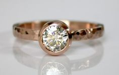 A delicate 14k pink gold hammered setting with a sparkling 5mm Moissanite