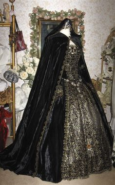 This is an interpretation of a Renaissance gown. It's tough to see past the cape if it's accurate. The amount of gold-cloth brocade makes me doubt it, but....still....LABEL: Gothic Renaissance Wine Velvet Fantasy Gown Custom