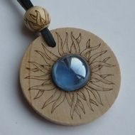 """Wooden pendant """"Fire Ice"""" decorated with pyrography and glass"""