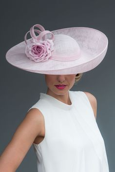 Joanne Edwards Millinery / London based milliner who handcrafts a unique and luxurious range of stylish ladies hats, headpieces and bridal accessories for weddings and race days