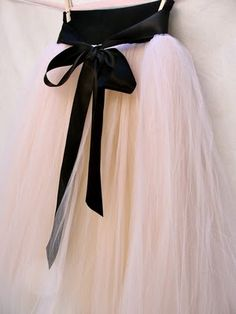 tulle skirt + big black bow = irresistible. I'd flit around the house all day in this.