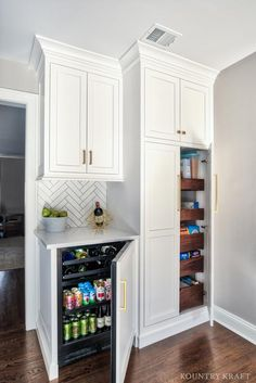 Custom Kitchen Cabinets Hide Beverage Fridge and Pantry