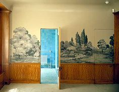 The bedroom of Stephen Courtaulds Suite is very tranquil with block printed wallpaper of scenes from Kew Gardens.