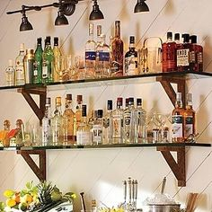 33 Insanely Clever Things Your Small Apartment Needs. Use shelves for your bar and glassware. Saves space and money.