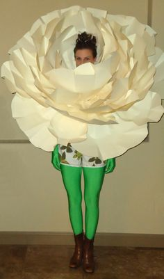 Giant paper flower. Crazy green tights... that would be another way to do it rather than putting them all in green dresses. CHEAP.