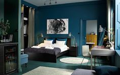 """A medium sized bedroom furnished with a black-brown bed for two combined with chest of drawers used as bedside tables. Source by darkmuze Next Previous The name """"home of two creatives"""" says it…Maritime bedroom - bedroom furnished in white and blue . Blue Green Bedrooms, Bedroom Green, Bedroom Black, Large Bedroom, Trendy Bedroom, Ikea Bedroom Design, Bedroom Decor, Bedroom Ideas, Bedroom Curtains"""
