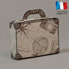 une valise à dragées pour une cérémonie sur le thème du voyage, preparez vous à passer une cérémonie surprenante.