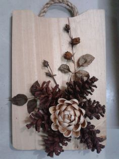 Pine cone, pistachio shell and baby rose
