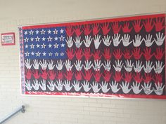 Veterans Day Bulletin Board where students make a flag out of their hands. Each student is then able to dedicate a hand in honor or in memory of a veteran! Kids Bulletin Boards, November Bulletin Boards, Military Child Month, Veterans Programs, Veterans Day Celebration, Veterans Day Activities, Patriotic Crafts, Patriotic Symbols, Patriotic Decorations