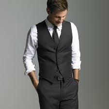 In a dark blue or gray, and with a plum colored tie/bow tie.
