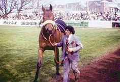 Red Rum is probably the most famous racehorse the world has ever seen.  Everyone knows his name, whether a racing enthusiast or a once a year Grand National punter.   He was foaled in 1965 and trained on the Southport sands by Ginger McCain.  Red Rum won the 1973, 1974 & 1977 Grand Nationals & was runner-up in 1975 and 1976 - an unparalleled record.    Red Rum, died in 1995 at the age of 30 and is buried near the winning post at Aintree. This is his story, a tale of courage and…