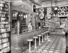 "Washington, D.C., circa 1920. ""People's Drug Store, 14th & U Streets, interior."""