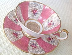 Paragon, England. Exquisite and very unique hand painted tea cup and saucer. It is in lovely pink and white stripes with gold details in a white background. Centers are embellished in beautiful gold design. It is in excellent condition. No chips, cracks or crazing. Please check the Shipping & Policies for this listing. We will ship to most countries, but we will not ship to any European Union countries. If your country is not in the Shipping to drop down list, please contact the shop owne...