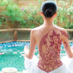Buddha tattoo.-love the color feminine & beautiful detail & line work