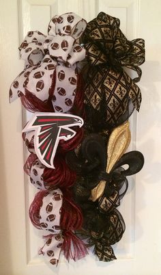 """New Orleans Saints - Atlanta Falcons house divided deco mesh swag. Approximately 14"""" wide and 30"""" long.  How is your house divided?!  Tell me your two favorite teams and let me customize one just for you!"""