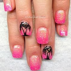Pink and gold inspired Palm Tree Nail Art design. You can see that the gold glitter is sprinkled on top for effect. While the palm trees are painted in black polish beneath the gold to make it look like it's shining.