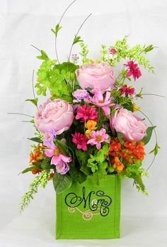 Send this beautiful silk arrangement for a Mother's Day gift that will last way beyond the day we celebrate. A burlap box is embroidered with Mom and holds an array of gorgeous silk florals. This is a