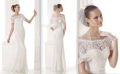 MERRY Colección Modern Bride Vestido de corte recto de encaje con escote envolvente y transparencia de escote corazón. Cuerpo con manga corta y cinturón de grosgrain fino con lacito en el centro. Desde 970,00 €*