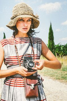 Old-Fashioned Woman with a Retro Camera in the Italian Countryside by Giorgio Magini for Stocksy United