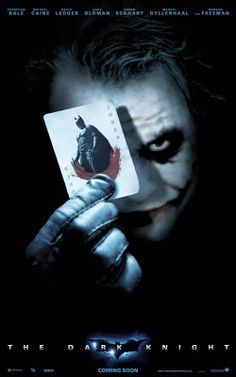 This poster if for the Batman the Dark Knight move. The jokers face and the playing card he is holding are light colored over a dark background. The Batman is black inside all the white drawing the eye to it.